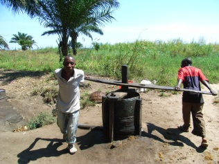 The good oil: Kudra (l) and his brother, Said (r), making palm oil